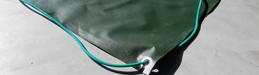 Copertura invernale con borchie ed elastico su misura per la tua piscina
